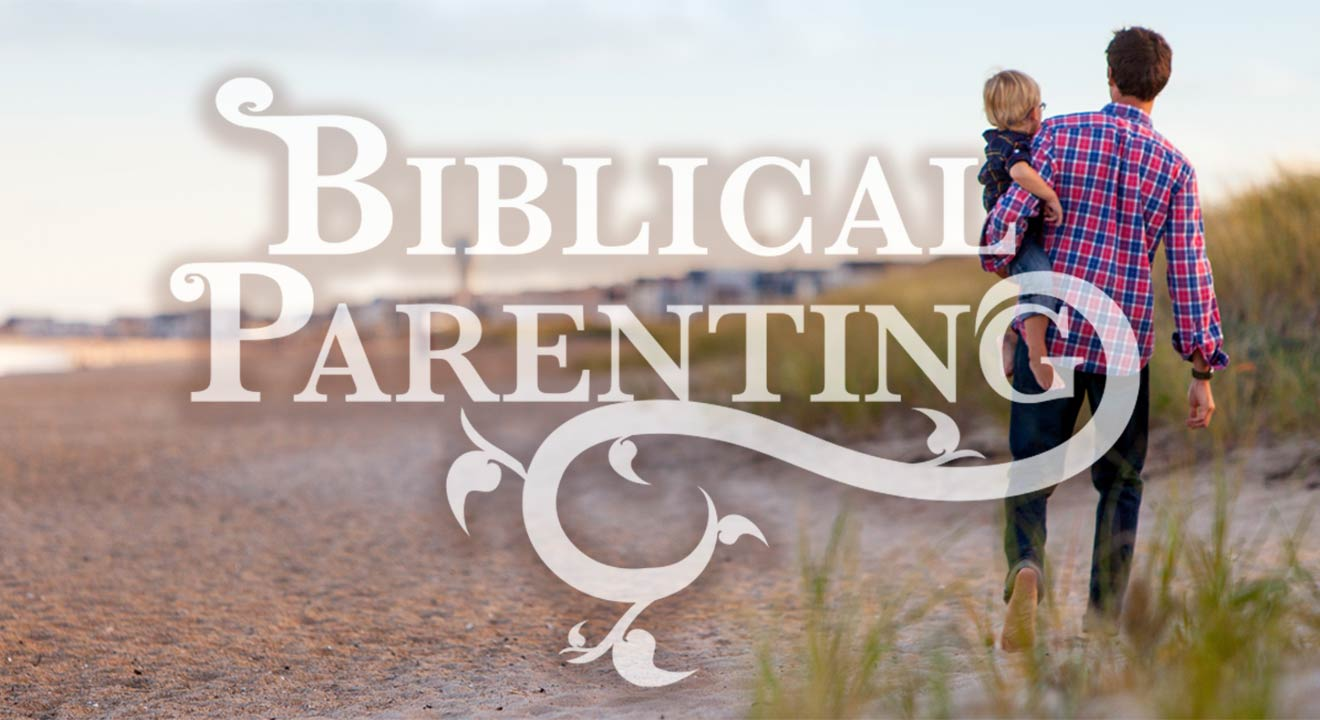 Biblical Parenting - man holding child on beach
